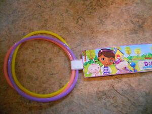 12 sets of Doc McStuffins birthday party favor bracelets with Custom Disney tag