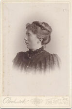 CABINET CARD, PROFILE VIEW OF YOUNG WOMAN LOOKING ANNOYED. NYC, NY.