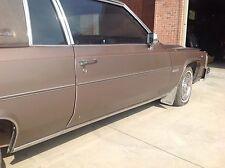 1983 Cadillac coupe de ville passenger side door