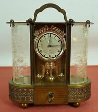 PENDULUM CLOCK AND MUSIC BOX SCHMID. BRASS AND CRYSTAL. CIRCA 1900.