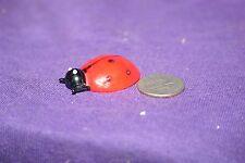 Miniature glass ladybug figurine