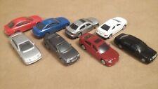 Unknown 1/64 S Size Plastic Autos (8)