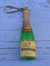 Porte-clé des années 1960-70, bouteille de Champagne Mercier claire