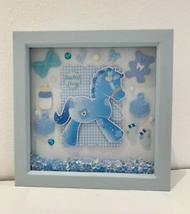 A cute blue framed gift for a new baby boy