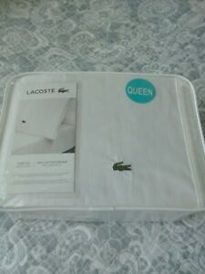 Lacoste white sheet set. us queen/uk king.size..new in pack