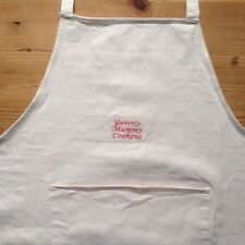 Apron with front pocket with wording in Red   'Yummy Mummy Cooking '