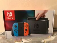 Nintendo Switch - 32GB Console (with Neon Red/Neon Blue Joy-Con)