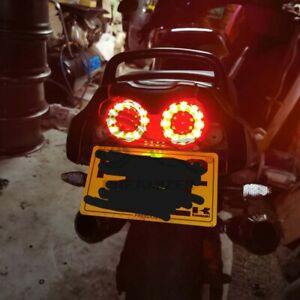 Universal Motorcycle LED Dual Tail Lights Brake Turn Signals Integrated Light