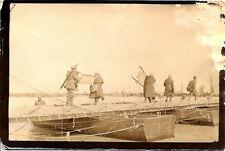 1916 PHOTO OF SOLDIERS IN UNIFORM CARRYING SUPPLIES ACROSS FOOT BRIDGE