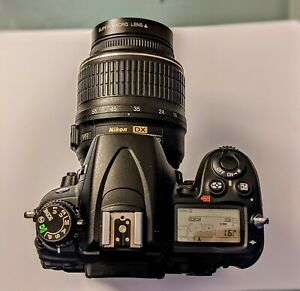 Nikon D7000 with Nikon 18-55mm lens and DR7000 battery pack expansion