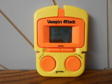 VAMPIRE ATTACK vintage hand held electronic game 1990's SYSTEMA orange/yellow