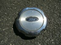One factory 2004 to 2008 Ford F150 chrome center cap hubcap