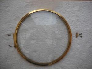 A GOOD CLEAN BRASS BEZEL & GLASS FOR A SMITHS ENFIELD MANTEL CLOCK.