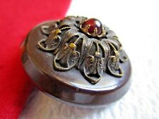 5957 – Raised Brass Filigree & Red Claw-Set Jewel OME on Old Celluloid Button