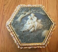 A gold jewelry vintage music box