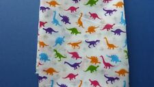 1 metre of polycotton with small brightly coloured dinosaurs on white