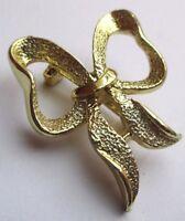 broche rétro noeud bijou vintage couleur or effet diamanté signé GERRYS 1845
