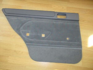 NOS 1995-1996 FORD ESCORT TRACER REAR DOOR PANEL COVER LH MANUAL OEM