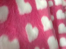 Pink faux fur fabric with white heart pattern one metre