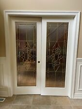 Solid wood double doors with glass inserts