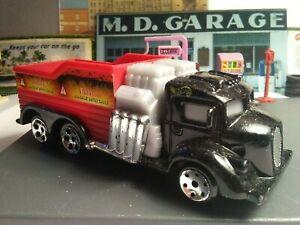 "Hotwheels semi truckin dump Explosive handle with care 5"" long black& red 1999"