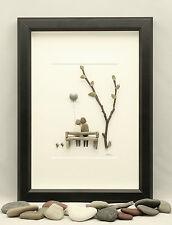 Pebble art Couple sat on a bench