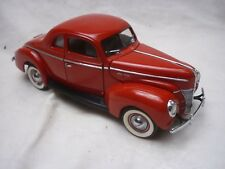 A Danbury mint scale model car of a 1940 Ford coupe,  no box, loose