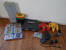 35 Nintendo 64 games, 2 controllers, cables, N64 console, mario party READ