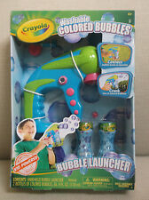 CRAYOLA HAND-HELD BUBBLE LAUNCHER WITH 2 BOTTLES OF WASHABLE COLORED BUBBLES