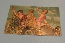 1910 Era Children Driving Car Embossed German Happy New Year Holiday Postcard
