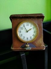 8 days Swiss Made Travel clock antique collectible in redbrown? leather case.