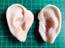 Severed ear props. Pair of matching gelatine ears.