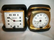 Two Vintage Wind Up Equity Travel Alarm Clocks in Cases