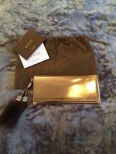Gucci Gold Leather Clutch