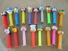 Pez Dispensers - Garfield - Mickey Minnie Mouse - Goofy - Daffy . quantity 18 .