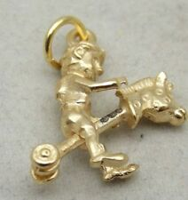 3D 9Ct GOLD CHARM OFCHILD RIDING A HOBBY HORSE