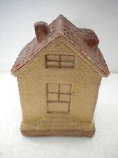 Tire lire à casser maison en plâtre
