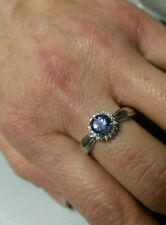 1.13 TCW Platinum  solitaire Tanzanite ring with diamond Halo