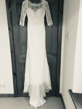 white lace wedding dress with V style back, 3/4 sleeves and small train, size 10