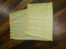 Two Pale Yellow Sheer Panels