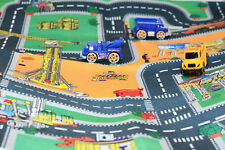 Construction play mat with three vehicles