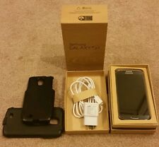 Samsung s4 16 gig rogers bundle (6 pics) small chip on the side (screen is gem)