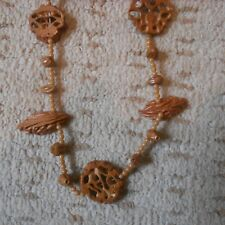wood and bead necklace, walnut motif