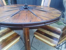 Rustic wagon wheel 2 tables and 10 chairs