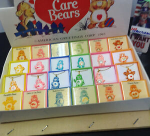 CARE BEARS DISPLAY BOX OF 24  PINS & NECKLACES AM GREETINGS CORP 1985 $3.50EA.