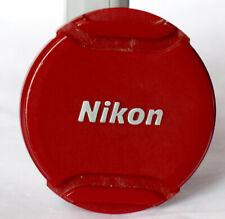 Red Nikon LC-N40.5 40.5mm edge pinch lens cap.
