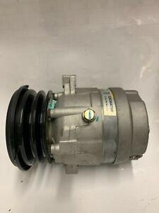 New NOS Daewoo V5 Compressor 5110384 24V 2GR Ear Mount for Excavator