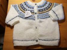 Jersey bebé. Hecho a mano realizado en lana. Color beige. Talla 12 -18 meses.