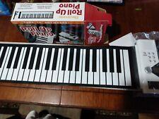 ELECTRONIC ROLL UP PIANO 49 KEY, 4 OCTAVE 100 DISTINCT RHYTHMS RECORDING & PLAYB