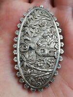 Ancienne broche en argent massif à identifier